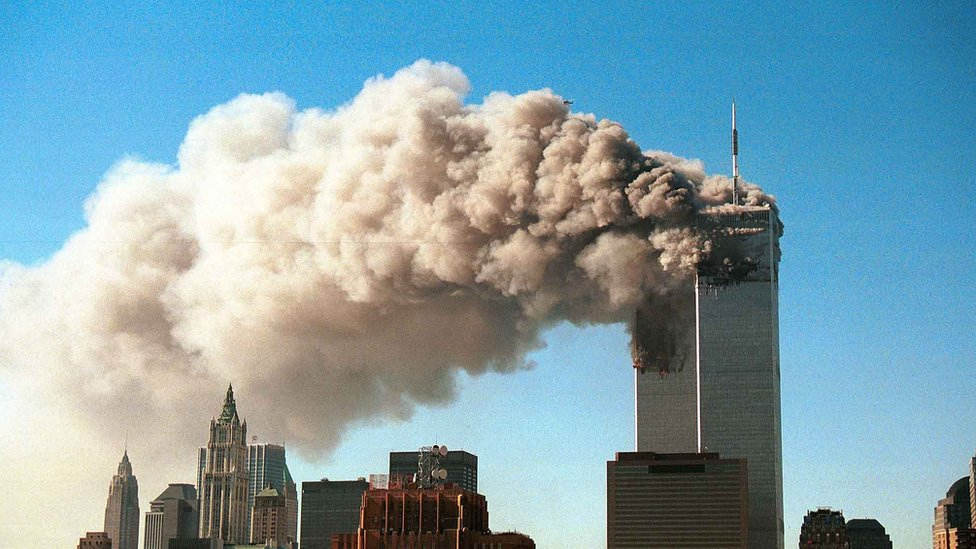 Smoke plumes from the twin towers of New York's World Trade Center, shortly after the attack on 11 September 2001`